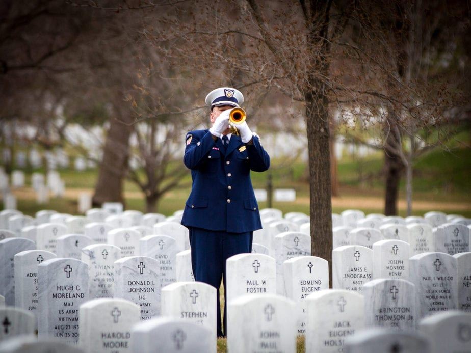 US Coast Guard Bugler in Arlington National Cemetery Section 55 | Arlington media, inc.